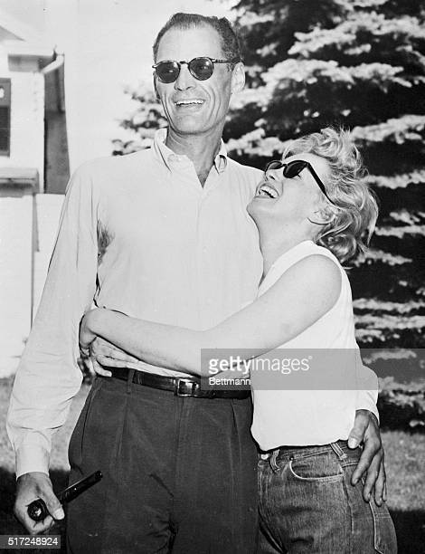 Marilyn Monroe hugs Arthur Miller at the playwright's 20-acre summer home here, June 25th. The wedding date is still indefinite.