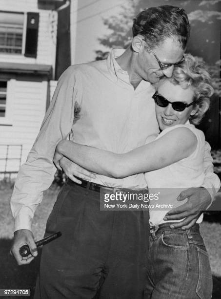Marilyn Monroe hugs her fiance Arthur Miller on the lawn of Miller's home