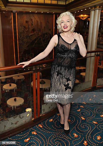 Marilyn Monroe impersonator Suzie Kennedy wears a sheer beaded gown Marilyn Monroe wore in the film 'Some Like It Hot' The dress will be displayed as...