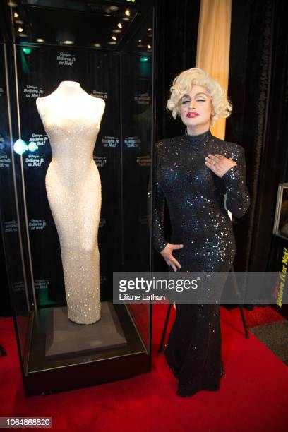 Marilyn Monroe Impersonator Venus DLite attends the Unveiling of Marilyn Monroe's Iconic 1962 'Happy Birthday Mr President' Dress at Ripley's Believe...