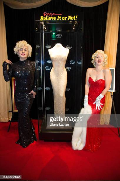 Marilyn Monroe Impersonators Venus DLite and Rachel Farrow attend the Unveiling of Marilyn Monroe's Iconic 1962 'Happy Birthday Mr President' Dress...