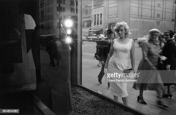 Marilyn Monroe in 1957 in front of store window on Fifth Avenue in New York New York