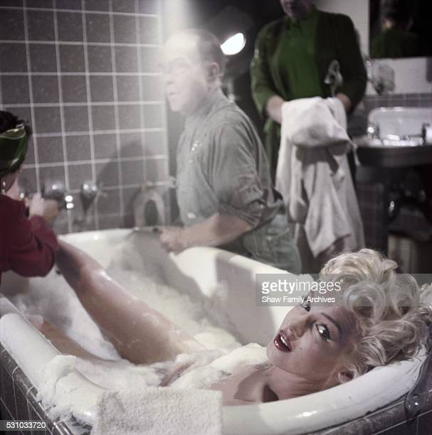 Marilyn Monroe in a bubble bath with actor Victor Moore in 1954 during the filming of 'The Seven Year Itch' in Los Angeles California