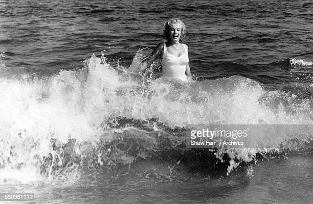 Marilyn Monroe in the water at the beach in 1957 in Amagansett New York
