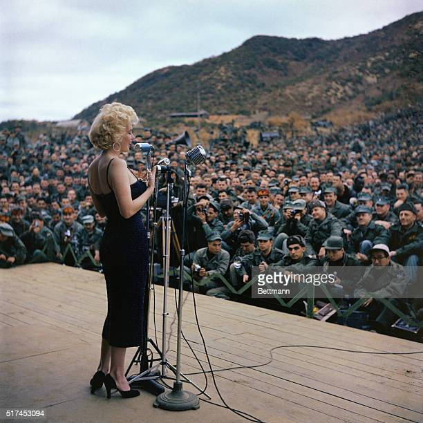 Marilyn Monroe is shown in this photo entertaining military troops in Korea