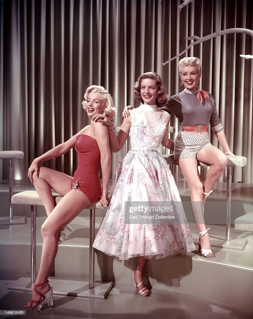 Marilyn Monroe, Lauren Bacall and Betty Grable pose for a portrait on the set of the 20th Century-Fox film 'How to Marry a Millionaire' in 1953 in Los Angeles, California.