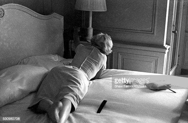 Marilyn Monroe lies on a bed talking on a telephone in a room at the Hotel St Regis in 1954 in New York New York