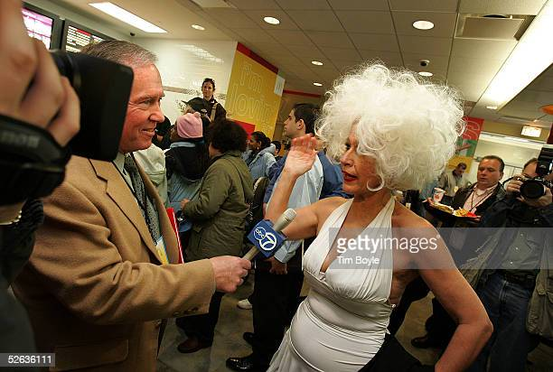 Marilyn Monroe lookalike Barbara Ann Patton is interviewed during the opening celebration of the new 50th Anniversary McDonald's April 15 2005 in...