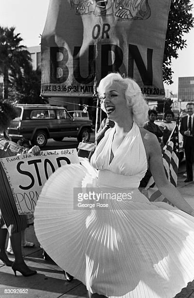 Marilyn Monroe lookalike entertains a crowd of onlookers outside the 1980 Hollywood California Adult Entertainment Awards held at the Palladium