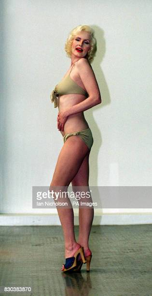 Marilyn Monroe lookalike Pauline Bailey models a bikini worn in 1960 by the star in her last film The Misfits The costume is to go on display at the...