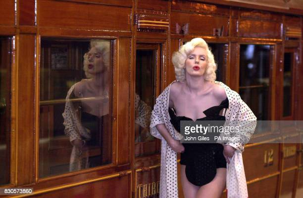 Marilyn Monroe lookalike Pauline Bailey models a rare swimsuit worn by screen goddess Marilyn Monroe at the National Railway Museum in York The...