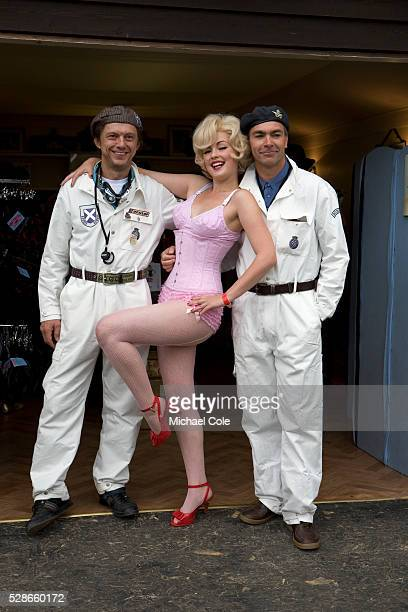 Marilyn Monroe lookalike with two Ecurie Ecosse team mates/mechanics