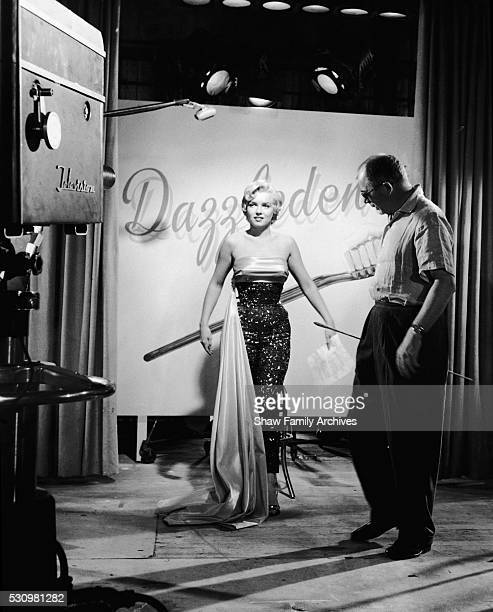 """Marilyn Monroe on set with director Billy Wilder filming the Dazzledent Toothpaste commercial sequence in 1954 for """"The Seven Year Itch"""" in Los..."""