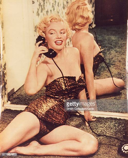 Marilyn Monroe pinup photo speaking on a telephone and reclining against a mirror 1950