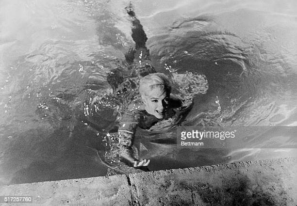 Marilyn Monroe playing Ellen Arden swims naked in Something's Got to Give The movie was never completed due to Monroe's sudden death during production
