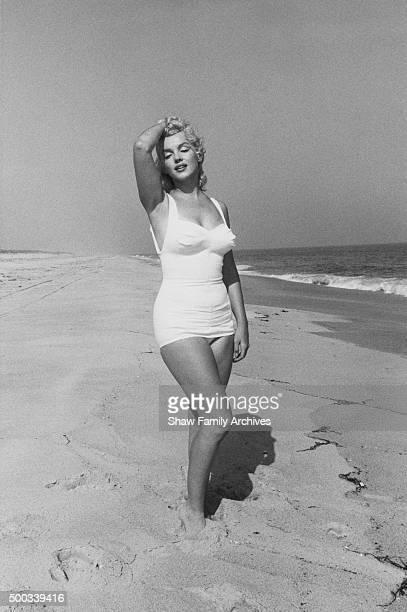 Marilyn Monroe poses as Aphrodite on the beach in 1957 in Amagansett, New York.