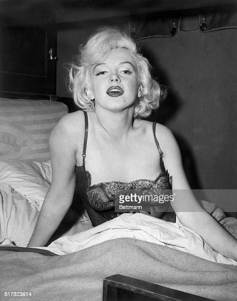 Marilyn Monroe Poses In A Bed Wearing Sexy Lingerie During The Shooting Of Her Film Some