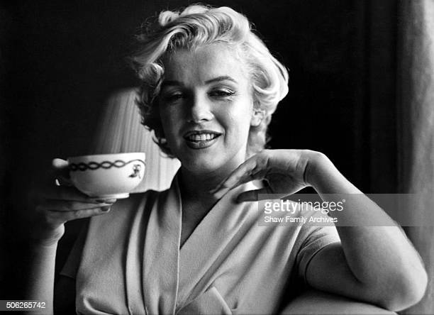 Marilyn Monroe poses with a coffeee cup in a room at the Hotel St Regis in 1954 in New York New York