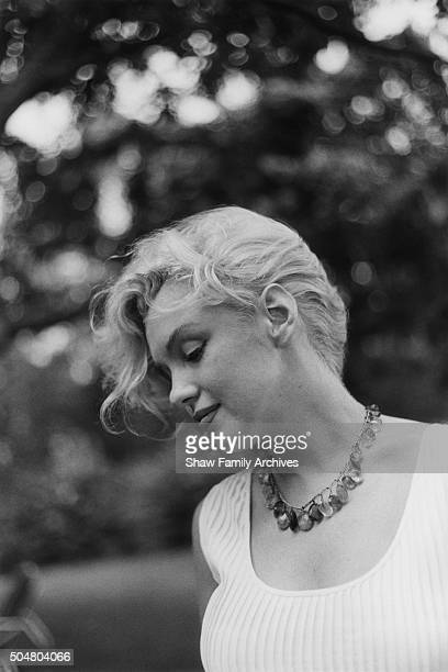Marilyn Monroe poses with an amber bead necklace in 1957 in Amagansett New York