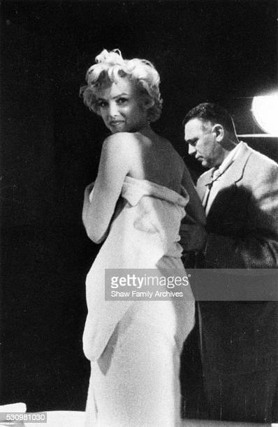 Marilyn Monroe prepares for a bathtub scene in 1954 on set with cinematographer Milton Krasner during the filming of 'The Seven Year Itch' in Los...