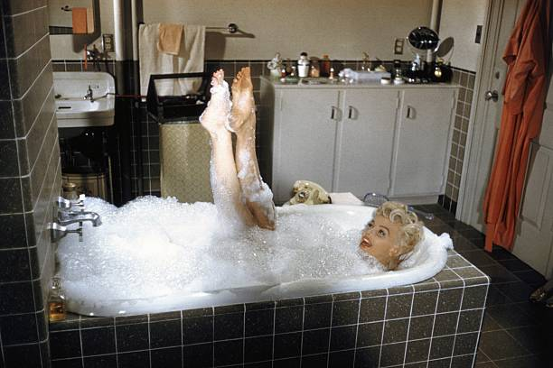Marilyn Monroe reclines in a bathtub in 1954 during the filming of The Seven Year Itch in Los Angeles California