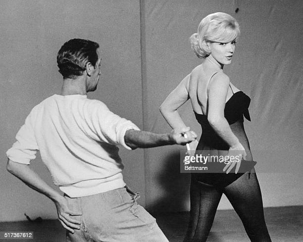 Marilyn Monroe rehearses a dance routine for the film Let's Make Love with choreographer Jack Cole.