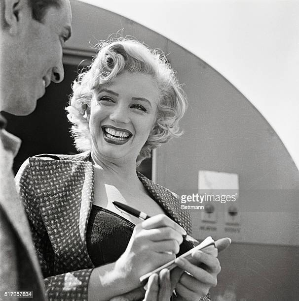Marilyn Monroe Signing Autograph for Young Man