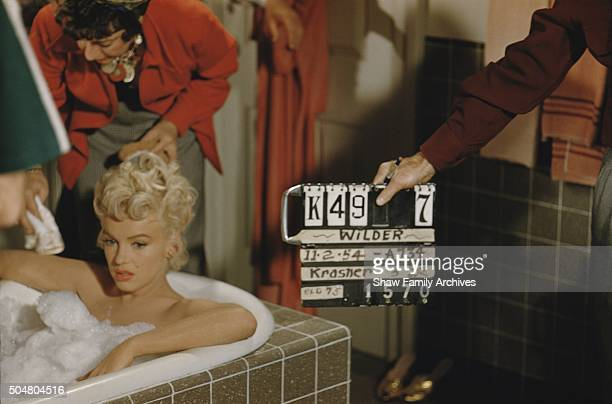 Marilyn Monroe sits in a bubble bath in 1954 during the filming of 'The Seven Year Itch' in Los Angeles California