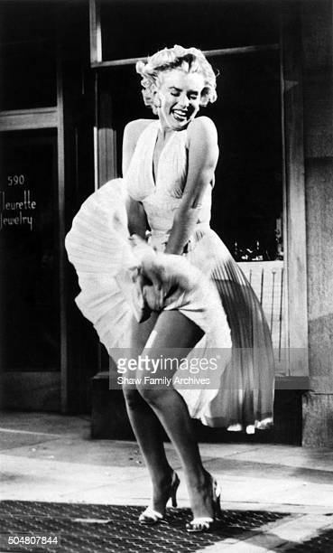 """Marilyn Monroe standing over a subway grate with her white dress blowing in 1954 during the filming of """"The Seven Year Itch"""" in Los Angeles,..."""