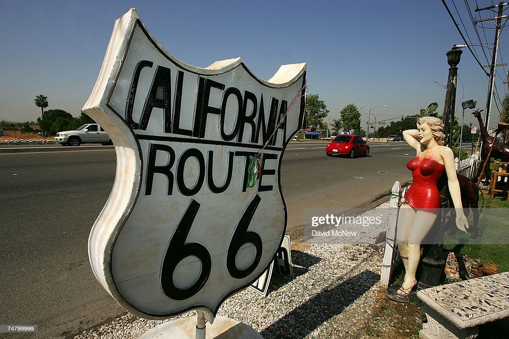 A Marilyn Monroe statue stands along old Route 66 on June 15, 2007 in Rancho Cucamonga, California. Route 66 opened in 1926 to become an icon of American motoring freedom. It stretched from Chicago to Los Angeles and became a western migration route for people looking for work during the great depression of the 1930s or to escape the Dust Bowl disaster. Later it offered vacation getaways and driving adventures until 1985 when it was decommissioned as a federal highway. Today the motels, gas stations, and roadside attractions along the 'Mother Road' are disappearing at an alarming rate. Route 66 aficionados try to preserve some reminders of the by-gone era ? restoring some buildings, collecting memorabilia, and erecting thousands of new signs that read 'Route 66' - but most of the old landmarks are already in a state of decay or destroyed by vandals and neglect. Freeways, modern hotel chains, developer's projects, and even tourist attractions are blotting out the original reminders of the highway that inspired countless movies, books, and songs about life on the Western highway. Last week the National Trust for Historic Preservation included the old motels of Route 66 on its list of the 11 most endangered historic places.