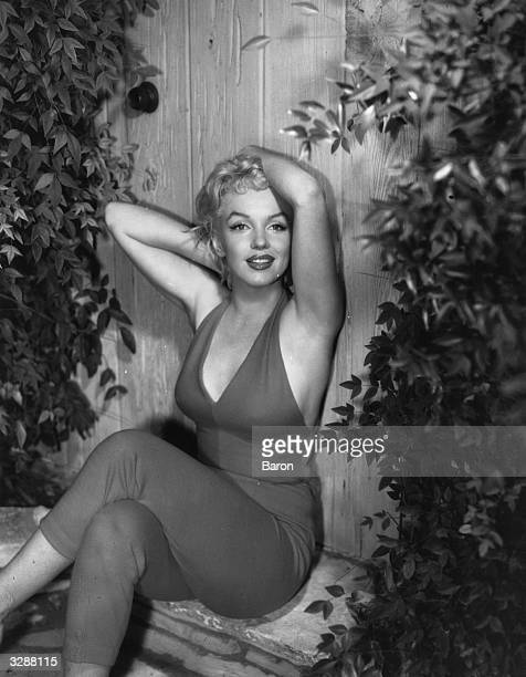 Marilyn Monroe the Hollywood film actress enjoying a seductive stretch