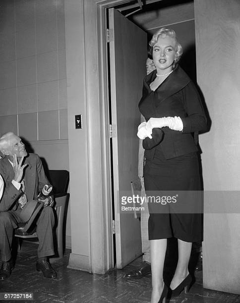 Marilyn Monroe, walks into a Santa Monica court to win a divorce form ex-baseball player Joe DiMaggio, gets a stare of unqualified admiration from a...