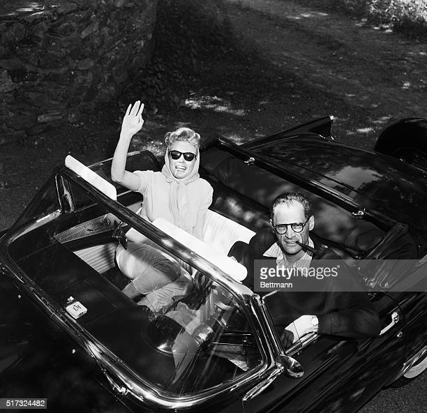 Marilyn Monroe waves from Arthur Miller's convertible as the newlyweds leave their Roxbury Connecticut home for a picnic on the day after their...
