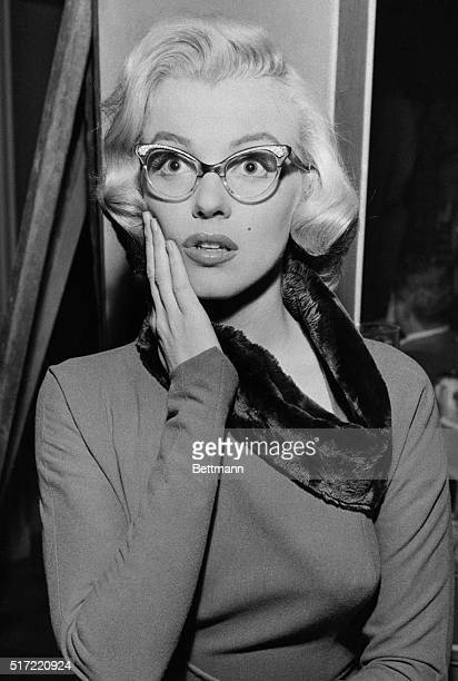 Marilyn Monroe wearing the glasses she wore in the film How to Marry a Millionaire Monroe herself wore glasses offstage