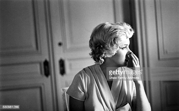 Marilyn Monroe with a cup of tea in a room at the Hotel St Regis in 1954 in New York New York