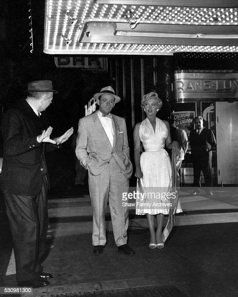 Marilyn Monroe with costar Tom Ewell and director Billy Wilder on the corner of 51st Street and Lexington Avenue while filming the famous...
