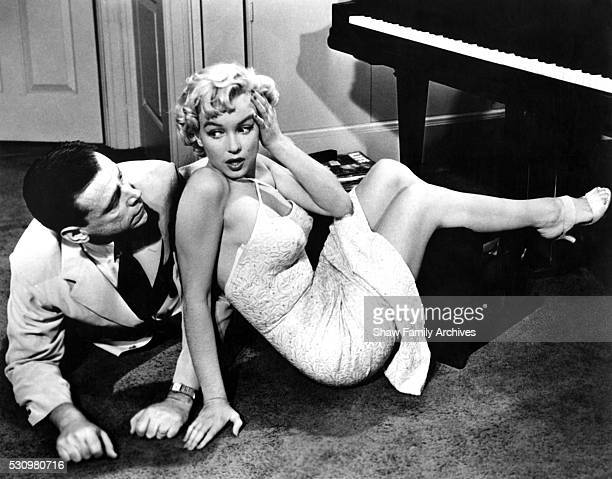 """Marilyn Monroe with co-star Tom Ewell in 1954 during the filming of """"The Seven Year Itch"""" in Los Angeles, California."""