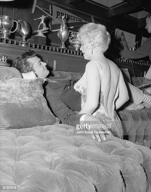 Marilyn Monroe with costar Tony Curtis during the filming of 'Some Like It Hot' directed by Billy Wilder