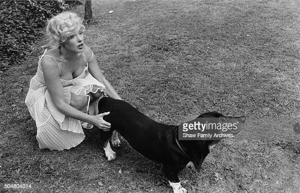 Marilyn Monroe with her Basset Hound Hugo in 1957 at her home in Amagansett, New York.