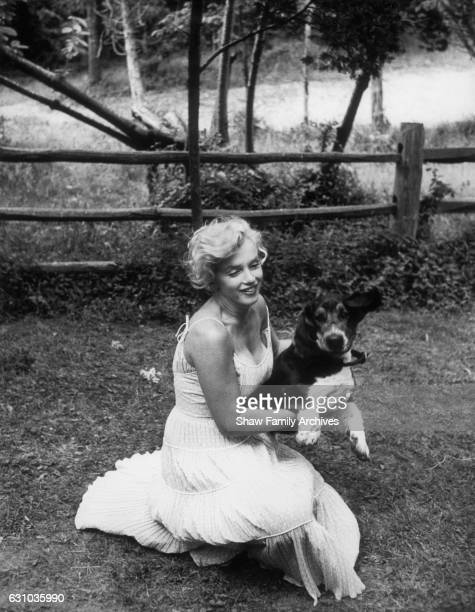 Marilyn Monroe with her Basset Hound Hugo in 1957 in Amagansett New York