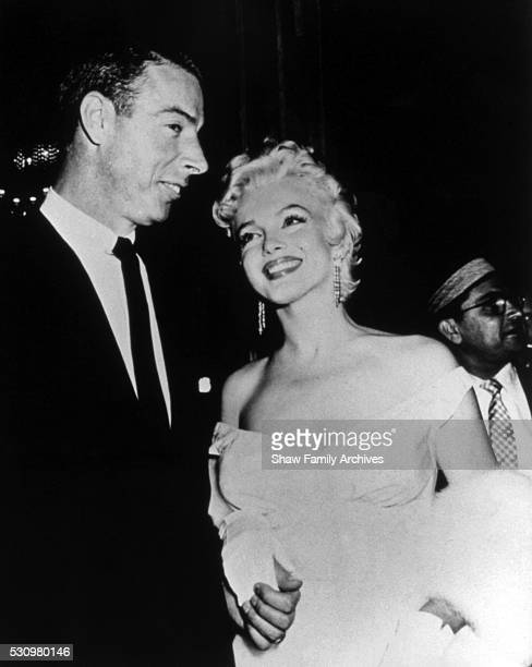 """Marilyn Monroe with her husband, baseball player Joe Dimaggio, in 1955 at the film premiere of """"The Seven Year Itch"""" in New York, New York."""