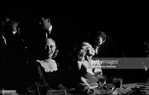 Marilyn Monroe with her husband the playwright Arthur Miller and Susan Wagner wife of New York City Mayor Robert Wagner in 1957 at the premiere for...