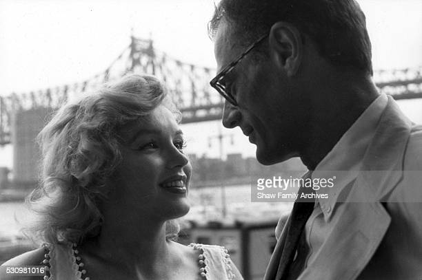 Marilyn Monroe with her husband the playwright Arthur Miller in front of the Queensboro Bridge in 1957 in New York New York