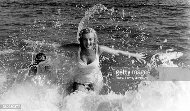 Marilyn Monroe with her husband, the playwright Arthur Miller, in the water at the beach in 1957 in Amagansett, New York.