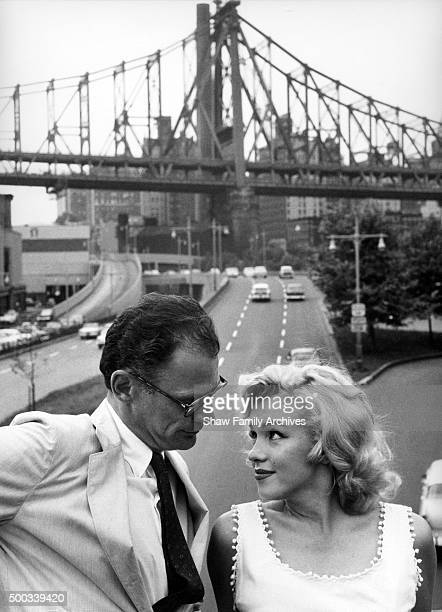 Marilyn Monroe with husband and playwright Arthur Miller in front of the Queensboro Bridge in 1957 in New York New York
