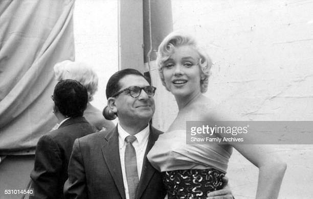 Marilyn Monroe with newspaper columnist Sidney Skolsky on set while working on the Dazzledent Toothpaste commercial sequence in 1954 for 'The Seven...