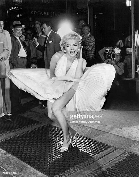 Marilyn Monroe with the skirt of her white dress blowing as she stands over a subway grate at the corner of 51st Street and Lexington Avenue in...