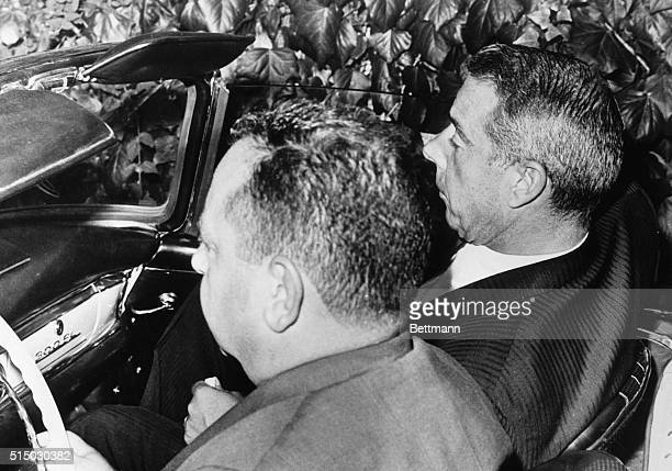Marilyn Monroe's attorney Milton Rudin and the actress' former husband Joe DiMaggio drive away from the funeral home here after completing...