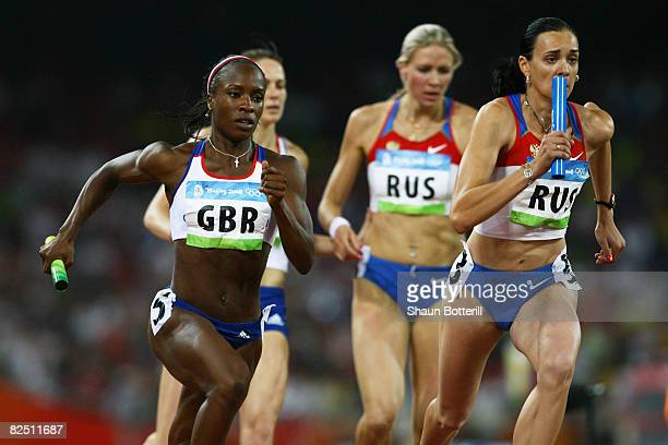 Marilyn Okoro of Great Britain and Liudmila Litvinova of Russia compete at the start of the third leg of the Women's 4 x 400 Relay Round 1 Heat 1at...