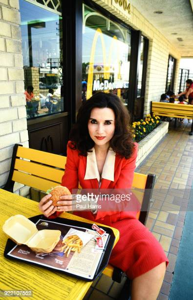 Marilyn Vos Savant photographed eating a Macnolds burger and fries in San Diego she is an American who is known for previously having the highest...